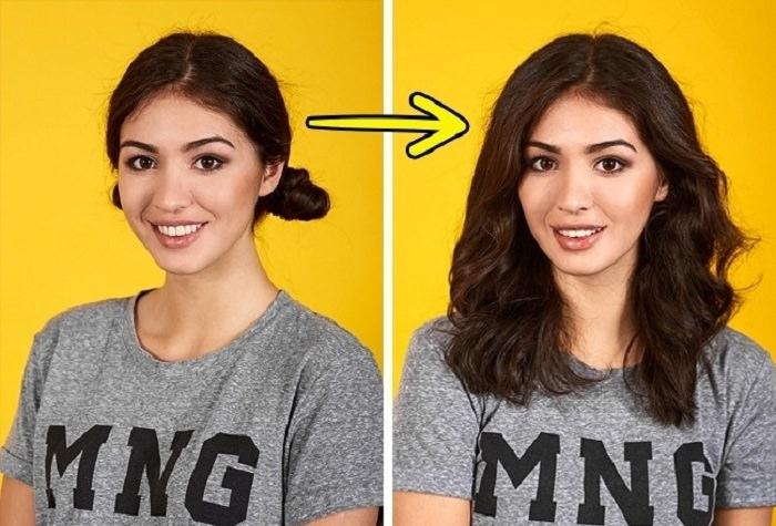 אישה עם שתי קוקיות שמפזרת את השיער