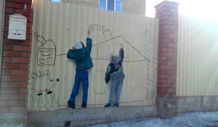 יצירות גרפיטי שמשדרגות את הרחובות: ילד מצייר על קיר שעליו מצוייר ילד שמצייר על הקיר