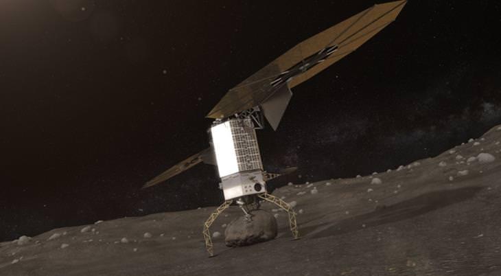 רובוט אוחז בפני שטח של אסטרואיד