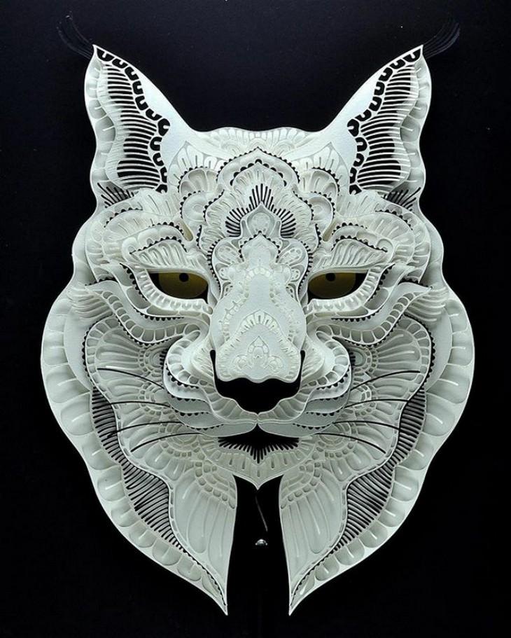 יצירת חיתוך נייר בצורת ראש של חתול בר